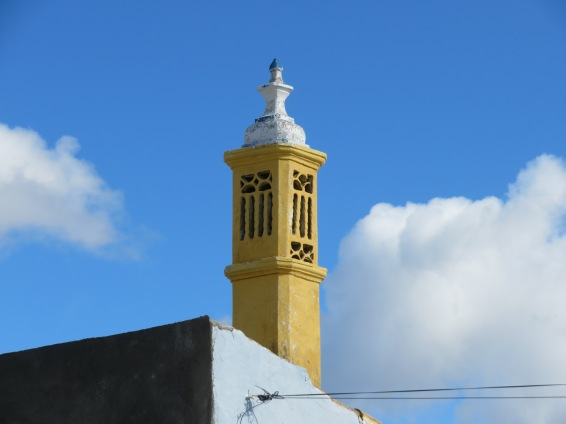I loved the yellow chimney against the blue sky.
