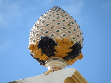 A large ceramic decoration on the top of a building