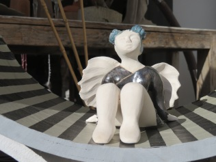 A tiny angel dancer in a window