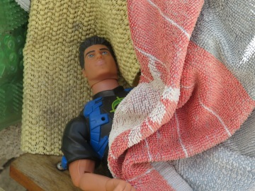 GI Joe, wrapped safely in a blanket and I think, hidden by somebody.