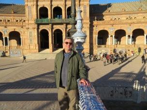 A happy man exploring Seville and discovering the Plaza de España
