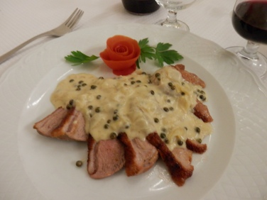 Roasted duck with peppercorn sauce