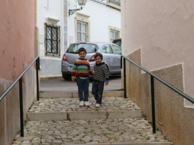 """These two little boys were so cute. They were racing up and down the steps but counting to get a head start.......uma..........doosh.....which I think was a combination of Portuguese and English....followed by """"tree"""" then they would giggle and race each other to the bottom or top!! They happily posed for me."""