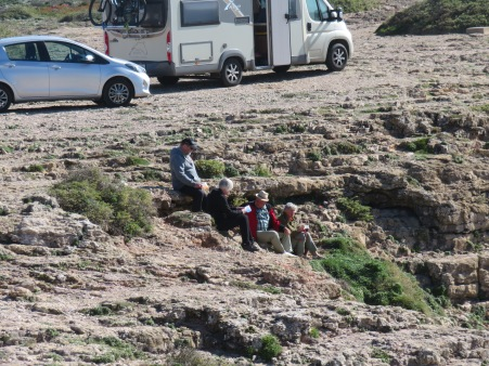 Brave souls picnicking on the edge of the cliffs near the parking