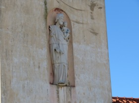I came across this old dilapidated building with this statue of St. Anthony sitting in a niche on the wall.