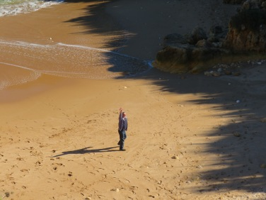 Marc enjoying a stroll on the sand........he got his feet wet from an unexpected surge of waves!