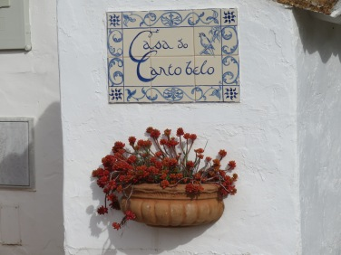 A wall decoration near the patio of a beautiful tiny cottage, tucked into the side of the mountain and not currently occupied. A rental maybe????