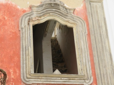 I love the detail of the framed window and the peek at the old staircase inside.....calling out to me to come and have a look.