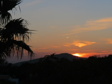 The sunset from their villa rooftop