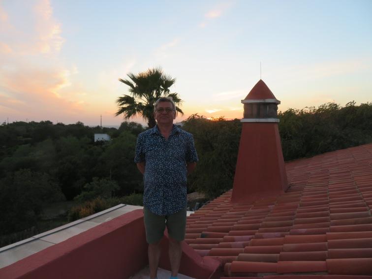 Mon mari on the rooftop capturing the sunset.