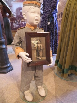 I liked how they displayed many of the costumes. I thought it was clever to have this mannequin holding the photo of a little boy wearing the same outfit.