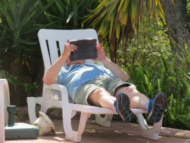 Marc found a shady spot near the pool and gave his ipad a workout!