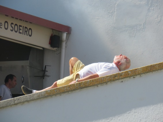 This fellow had a bad back and was stretching and doing exercises on the wall leading up to the church........perhaps looking for holy intervention!
