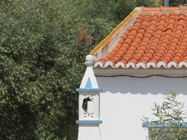 The rooster on this chimney was a bit different from many of the others. Not certain the photo captures it.