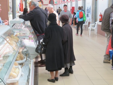I loved these two ladies. I swear they were no more than four feet tall, dressed in lovely felt hats, wool coats, carrying all their purchases and consulting on each one before purchasing. I wanted to take a photo of them face on but I thought it would have been an invasion so didn't