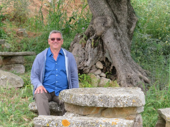 Marc enjoying a moment or two of solitude in the old church yard. These stone tables are tucked all around the property. Perfect for a picnic in the shade. Another day perhaps?