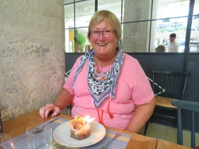 The birthday girl with her molten chocolate cake and home made chocolate ice cream....topped with a candle.