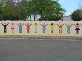 Creative tile work in the wall of the fence near the primary school