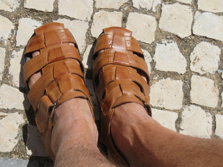 Marco bought himself a new paid of leather sandals.