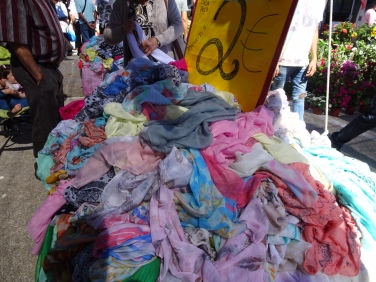 Scarves for 2 euros.....piled high and several tables.